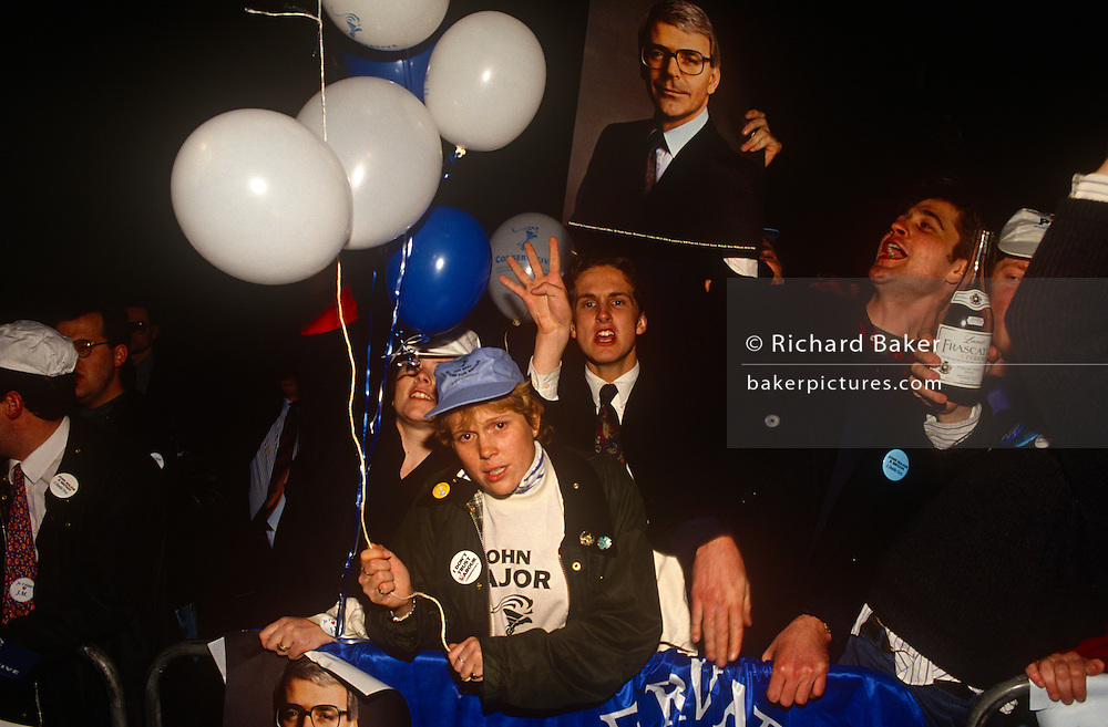 Supporters of British Prime Minister, John Major celebrate their party's re-election after replacing Margaret Thatcher, on 10th April 1992, outside Central Office in Smith's Square, London England. Major won the election and was the fourth consecutive victory for the Conservative Party although it was its last outright win until 2015 after Labour's 1997 win for Tony Blair.