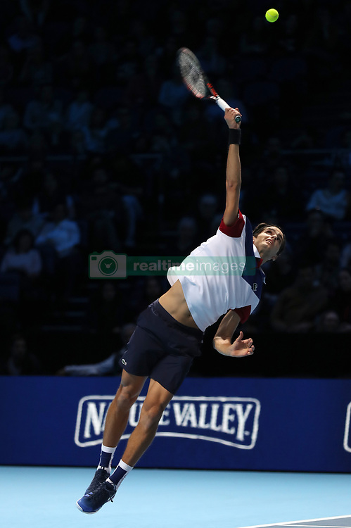 Pierre-Hugues Herbert serves during his doubles match with team mate Nicolas Mahut against Horia Tecau and Jean-Julien Rojur during day one of the NITTO ATP World Tour Finals at the O2 Arena, London.
