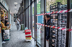 People keep a safe distance when queuing in front of the shop in Milan, Italy on April 18, 2020. Daily life scenes with the new anti-COVID-19 Coronavirus prevention measures. Photo by Carlo Cozzoli/IPA/ABACAPRESS.COM