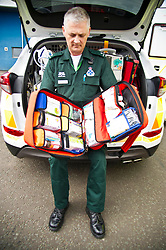 Pictured: Ian Stark checks the new pack of medicines that the specialist paramedics have been traed to dispense. <br /> <br /> Health Secretary Shona Robison met paramedics today on a visit to Scottish Ambulance Service's city station where she announced new funding for the service<br /> Ger Harley   EEm 24 April 2017