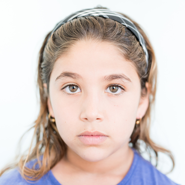 Avin Ahmed Qassem a 9 year old Yazidi from Dougre, northern Iraq. <br /> <br /> <br /> This is a series of portraits of Yazidi refugees who were stranded since April 2016 in Greece.  All of them survived the Yazidi Genocide by ISIS in August 2014 and most of them have lost family members.