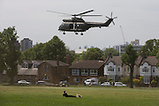 An Royal Air Force Puma helicopter takes off after only a few moments on the ground in Ruskin Park, a public space in the south London borough of lambeth.