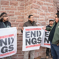 Protesters left to right, Bobby Leonard Mason, Roberto Nutlouis and Sheldon Natoni speak with Seth Damon, far right, the budget and finance committee chairman for the Navajo Nation in front of Navajo Nation Council Chambers, Tuesday, Dec. 18, 2018 in Window Rock.