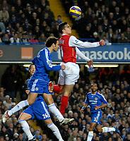Photo: Ed Godden.<br /> Chelsea v Arsenal. The Barclays Premiership. 10/12/2006.<br /> Arsenal's Robin Van Persie wins the ball.