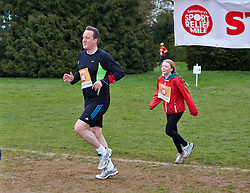 © Licensed to London News Pictures.  23/03/2014. OXFORD, UK. Prime minister DAVID CAMERON (left) at the end of the Oxford Sport Relief Mile. Photo credit: Cliff Hide/LNP