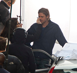 """Day two of filming. Brad Pitt on the set of the movie """"World War Z"""" being shot in the city centre of Glasgow. The film, which is set in Philadelphia, is being shot in various parts of Glasgow, transforming it to shoot the post apocalyptic zombie film..© pic : Michael Schofield."""