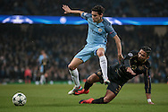 Jesús Navas (Manchester City) is tackled by Emilio Izaguirre (Celtic) during the Champions League match between Manchester City and Celtic at the Etihad Stadium, Manchester, England on 6 December 2016. Photo by Mark P Doherty.
