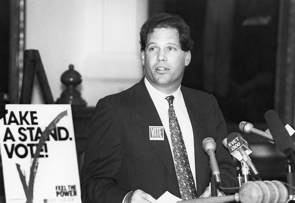 ©1990  Texas Secretary of State George Bayoud at a press conference.