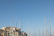 Yacht masts and citadel under blue sky, Calvi, Corsica, France