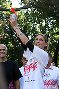 13 September 2009- NY, NY Uma Thurman blows horn to signal start at The Annual Komen New York City Race for the Cure held at West 77th Street and Central Park West on September 13, 2009 in New York City.  Photo credit: Terrence Jennings/Sipa Press