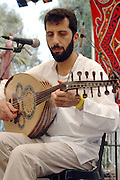 Nabil Abu Nikola with an Ud - Lute, live on stage at the Jacob's ladder festival, Israel, May 2005