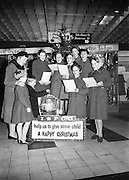 Joseph and John Toser of Rathgar and their mother contribrute to the ISPCC Carol Singers. The singers are Betty Hunt, Annette Moore, Sheila McCarthy, Angels Brady, Marie Nolan, Phyllis McGrath and Francis Clare..14.12.1962