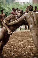 Indian men practicing the ancient sport of Kushti wrestling, Varanasi, India