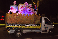 London, UK. 13th March, 2019. A vehicle bearing large figures of Theresa May, Boris Johnson, Michael Gove and Nigel Farage tours Westminster calling for the revocation of Article 50 on the evening of the vote on a 'No Deal' Brexit in the House of Commons.
