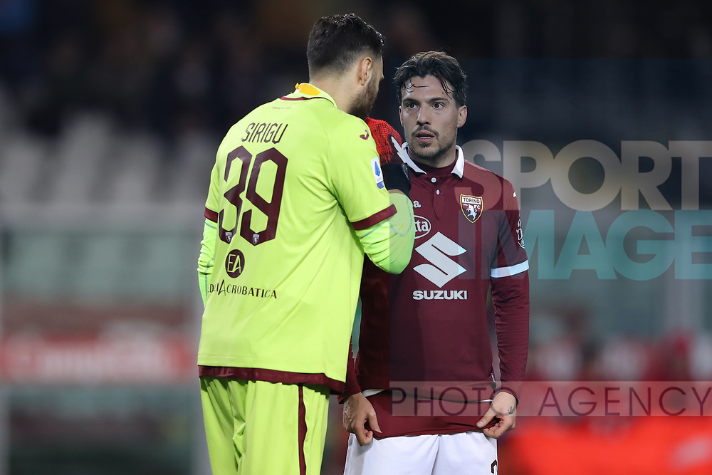 Salvatore Sirigu of Torino FC discusses with team mate Simone Verdi during the Serie A match at Stadio Grande Torino, Turin. Picture date: 8th February 2020. Picture credit should read: Jonathan Moscrop/Sportimage