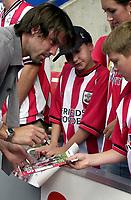 Photo: Greig Cowie.<br /> 31/08/2003.<br /> FA Barclaycard Premiership. Southampton v Manchester United. The Saint Marys Stadium.<br /> Jo Tessem signs autographs