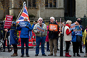 Pro Brexit protesters outside Houses of Parliament demonstrating on the 04th December 2018 In London in the United Kingdom. Pro Brexit campaigners protest as MPs begin five days of debate on Prime Minister Theresa Mays Brexit deal.