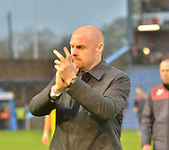 Burnely Manager, Sean Dyche applauds the fans for making the trip on a wet afternoon during the Sky Bet Championship match between Burnley and Preston North End at Turf Moor, Burnley, England on 5 December 2015. Photo by Mark Pollitt.