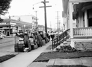 """Y-470911-02. NW 23rd & Johnson.  Old lady being evicted. Goods on the sidewalk. Caption: """"Woman, 75, ousted from her apartment by constable so landlady can renovate. Miss Irene Orth sits dejectedly on a stepladder amid furniture moved from her five-room apartment at 732 NW 23rd avenue on a district court eviction order Thursday. She said she intended to spend Thursday night guarding her belongings and declined police assistance."""" September 11, 1947."""