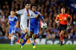 Basel Defender Behrang Safari (SWE) is challenged by Chelsea Midfielder Willian (BRA) during the first half of the match - Photo mandatory by-line: Rogan Thomson/JMP - Tel: 07966 386802 - 18/09/2013 - SPORT - FOOTBALL - Stamford Bridge, London - Chelsea v FC Basel - UEFA Champions League Group E