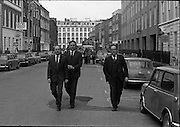 Cork Shoe Workers Protest.     K15..1976..24.03.1976..03.24.1976..24th March 1976..In protest at the winding up of the Cork shoe industry, 10 workers  from the Cork Shoe Co marched from Cork to Dublin to meet with TDs at Leinster House. The protest was to highlight the closure of The Cork shoe Co resulting in the unemployment of all the staff..Pictured TDs Pearse Wyse, Tom Meaney and Sean French are seen leading the protest down Molesworth Street towards Leinster House,Dublin