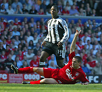 Photo. Andrew Unwin, Digitalsport<br /> NORWAY ONLY<br /> <br /> Liverpool v Newcastle United, FA Barclaycard Premier League, Anfield, Liverpool 15/05/2004.<br /> Newcastle's Titus Bramble is unable to stop Liverpool's Michael Owen firing home the equaliser.