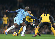 Yaya Toure of Manchester City plays the ball under pressure during the English Premier League match at the Etihad Stadium, Manchester. Picture date: December 18th, 2016. Picture credit should read: Simon Bellis/Sportimage