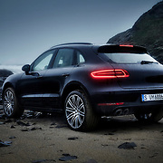 Porsche Macan parked on a sandy pebbled beach with waves crashing in the distance Ray Massey is an established, award winning, UK professional  photographer, shooting creative advertising and editorial images from his stunning studio in a converted church in Camden Town, London NW1. Ray Massey specialises in drinks and liquids, still life and hands, product, gymnastics, special effects (sfx) and location photography. He is particularly known for dynamic high speed action shots of pours, bubbles, splashes and explosions in beers, champagnes, sodas, cocktails and beverages of all descriptions, as well as perfumes, paint, ink, water – even ice! Ray Massey works throughout the world with advertising agencies, designers, design groups, PR companies and directly with clients. He regularly manages the entire creative process, including post-production composition, manipulation and retouching, working with his team of retouchers to produce final images ready for publication.