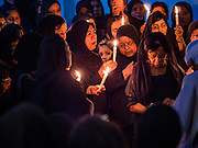 23 OCTOBER 2015 - YANGON, MYANMAR: Shia women hold a candlelight prayer to honor Hussein ibn Ali during Ashura observances at Mogul Mosque in Yangon. Ashura commemorates the death of Hussein ibn Ali, the grandson of the Prophet Muhammed, in the 7th century. Hussein ibn Ali is considered by Shia Muslims to be the third imam and the rightful successor of Muhammed. He was killed at the Battle of Karbala in 610 CE on the 10th day of Muharram, the first month of the Islamic calendar. According to Myanmar government statistics, only about 4% of the population is Muslim. Many Muslims have fled Myanmar in recent years because of violence directed against Burmese Muslims by Buddhist nationalists.   PHOTO BY JACK KURTZ