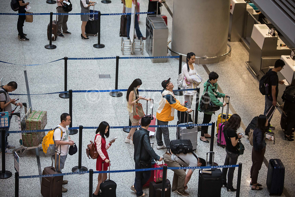 Travellers pass through the Shanghai Hongqiao Airport ahead of the October 1st golden week in Shanghai, China, on Sept. 29, 2015.