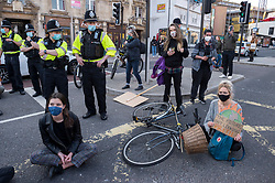 """© Licensed to London News Pictures;17/04/2021; Bristol, UK. Kill the Bill protesters hold a second march of the day through the city centre followed by a 20 minute sit down protest blocking the road during a ninth """"Kill the Bill"""" protest taking place in Bristol against the Police, Crime, Sentencing and Courts Bill during the Covid-19 coronavirus pandemic in England. The protest is taking place on the same day as the funeral of Prince Philip the Duke of Edinburgh. The Police, Crime, Sentencing and Courts Bill proposes new restrictions on protests. Some previous Kill the Bill protests in Bristol had violence. Photo credit: Simon Chapman/LNP."""