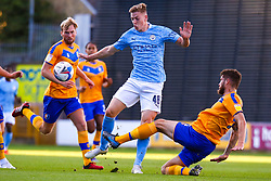 Ryan Sweeney of Mansfield Town slides in to tackle Liam Delap of Manchester City U21 - Mandatory by-line: Ryan Crockett/JMP - 08/09/2020 - FOOTBALL - One Call Stadium - Mansfield, England - Mansfield Town v Manchester City U21 - Leasing.com Trophy