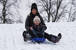 © Licensed to London News Pictures. 14/01/2021. Hexham, UK. Jessica,6, and her nan Sinead  enjoy sledging in the snow at Hexham Park following heavy snow last night. Photo credit: Ioannis Alexopoulos/LNP<br /> <br /> ***Permission Granted