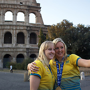 Australian Gold medal winners Jessicah Schipper (left) and Melissa Gorman photograph themselves after a 6am photo shoot outside the  Coloseum in Rome Italy on  Monday, August 3, 2009. Photo Tim Clayton