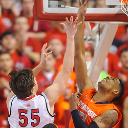 Rutgers Scarlet Knights forward Gilvydas Biruta (55) lays a basket in over Syracuse Orange center Fab Melo (51) during first half NCAA Big East basketball action between #2 Syracuse and Rutgers at the Louis Brown Athletic Center. Syracuse leads 40-34 at halftime.