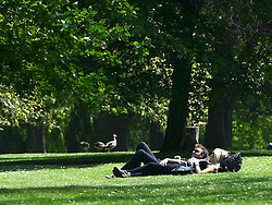 © Licensed to London News Pictures. 22/05/2012. London, UK A couple lie in the sun in Hyde Park.  People enjoy the sunshine in London's Royal Parks today 22 May 2012. Photo credit : Stephen Simpson/LNP