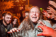 """Oct. 30, 2009 -- PHOENIX, AZ: JEANNIE RANKIN is attacked by ravenous zombies during the Zombie Walk in Phoenix Friday. About 200 people participated in the first """"Zombie Walk"""" in Phoenix, AZ, Friday night. The Zombies walked through downtown Phoenix """"attacking"""" willing victims and mixing with folks going to the theatre and downtown sports venues.  Photo by Jack Kurtz"""