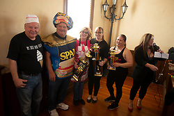 """""""Spam King"""" Paul Steele, second from left, poses with the winners of the recipe contest at the 22nd annual Spam Festival, Sunday, Feb. 16, 2019, in Isleton, Calif. Spam lovers competed for prizes by presenting their favorite Spam-infused foods, or entering the Spam-eating and Spam-toss contests. (Photo by D. Ross Cameron)"""
