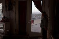 Tijuana 2015.<br /> From the last house of Latin America they can see the border from every window.<br /> <br /> La signora Esperanza mostra la frontiera da una delle porte della casa.