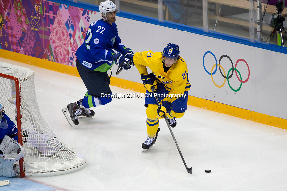 Loui Eriksson (SWE)-21,Marcel Rodman (SLO)-22 during Sweden vs Slovenia game at the Olympic Winter Games, Sochi 2014