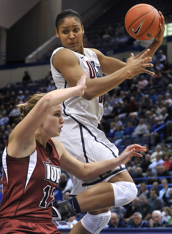 Connecticut's Maya Moore, top, drives to the basket while guarded by Indiana of Pennsylvania's Brianna Johnson during the first half of an NCAA college exhibition basketball game in Hartford, Conn., Wednesday, Nov. 10, 2010. (AP Photo/Jessica Hill)