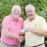 14 September 2012; PJ O'Neill, left, makes a presentation to Michael O'Brien, both from Clooneyquin GAA club, Co. Clare, during the 13th Annual All-Ireland GAA Golf Challenge 2012 Finals. Waterford Castle Golf Club, Waterford. Picture credit: Brendan Moran / SPORTSFILE *** NO REPRODUCTION FEE ***