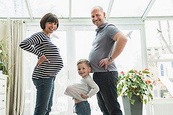 Portrait of family standing at home