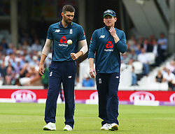 June 13, 2018 - London, England, United Kingdom - L-R England's Mark Wood and England's Eoin Morgan .during One Day International Series match between England and Australia at Kia Oval Ground, London, England on 13 June 2018. (Credit Image: © Kieran Galvin/NurPhoto via ZUMA Press)
