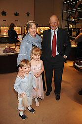 CHARLES & PATTI PALMER-TOMPKINSON and their grandchildren LILY & SASHA SEBAG-MONTEFIORE  at a party to celebrate the publication of 'Young Stalin' by Simon Sebag-Montefiore at Asprey, New Bond Street, London on 14th May 2007.<br />