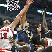 26 March 2012: Chicago Bulls center Joakim Noah (13) vies for the rebound with Denver Nuggets center JaValee McGee (34) during the Denver Nuggets 108-91 victory over the Chicago Bulls at the United Center, Chicago, Illinois, USA. NOTE TO USER: User expressly acknowledges and agrees that, by downloading and or using this photograph, User is consenting to the terms and conditions of the Getty Images License Agreement. Mandatory Credit: 2012 NBAE (Photo by Chris Elise/NBAE via Getty Images)