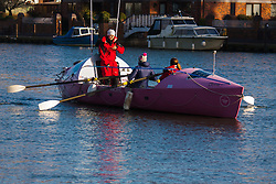 Marlow, Bucks, January 24th 2015. Olympic and Paralympic rowing medallists including Naomi Riches, Heather Stanning and Katherine Grainger join members of a Coxless Crew at Marlow at their boat naming ceremony. The Coxless Crew is a team of four women who have given up their jobs to undertake an epic six-month 8,446 mile adventure rowing their boat Doris across the Pacific ocean from Sanfrancisco to Cairns in Australia, to raise funds for charities Walking With The Wounded and Breast Cancer Care. PICTURED: Coxless Crew's Laura Penhaul chats with Olympic Gold medallist Heather Stanning (centre) and crewmate Emma Mitchell as they row Doris on the Thames.
