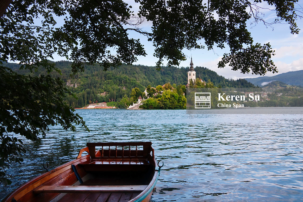 Boat on Lake Bled, Church of the Assumption on the island in the lake, Slovenia