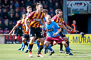 Bradford City defender Anthony McMahon (29) is first in line to defend the Scunthorpe United free kick during the EFL Sky Bet League 1 match between Scunthorpe United and Bradford City at Glanford Park, Scunthorpe, England on 26 March 2017. Photo by Simon Davies.