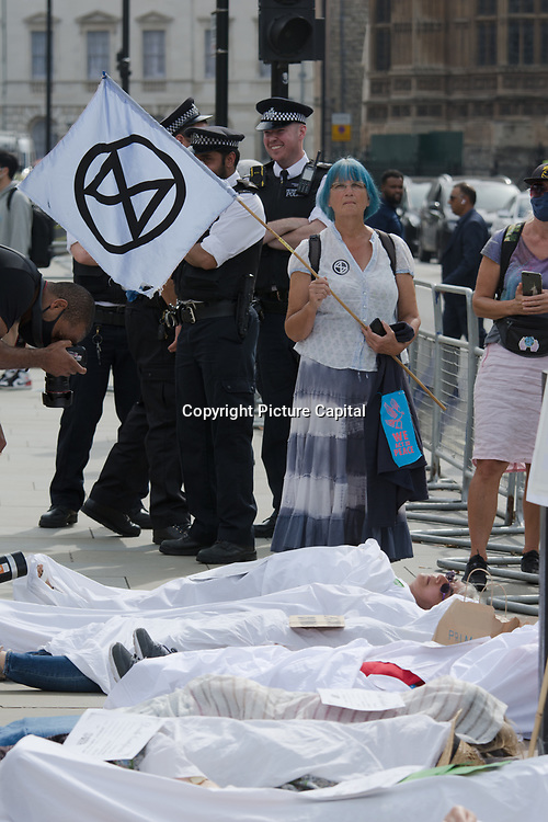 2021-09-06. Parliament Square, London, UK. Extinction Rebellion protest Order! Order! Code Red! Code Red! Welcome back Boris Johnson to Parliament and a Die-In.